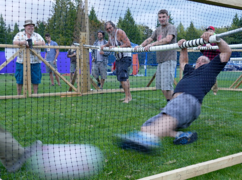 Human Foosball player reaching for the ball in Rogue Arts Festival in British Columbia
